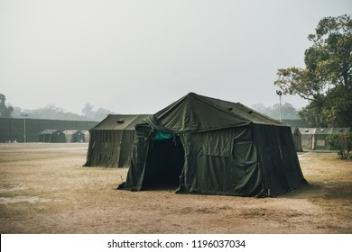the Army military camp in the forest, nobody, anywhere in the world. a refugee camp on the border. Field of the barracks. Military field medicine. Field hospital. Pow camp. army base, installation