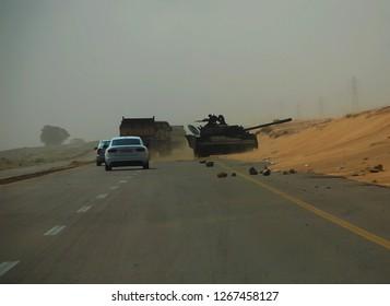Army of Muammar Gaddafi's Russian tank was destroyed on the Benghazi-Tripoli highway. The Arab Spring in Libya begins. April 7, 2011, Benghazi, Libya.