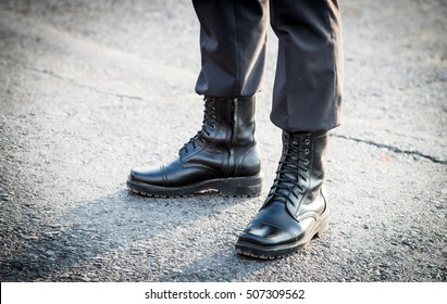 Army parade - military force uniform soldier boot row, Boot soldier, Old combat boots, A pair of high black leather boots, Military boot of a soldier standing still