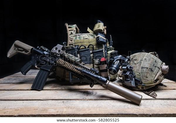 Army personal bulletproof vest,assult rifle,helmet with night-vision device/Bulletproof vest,rifle and helmet on black background