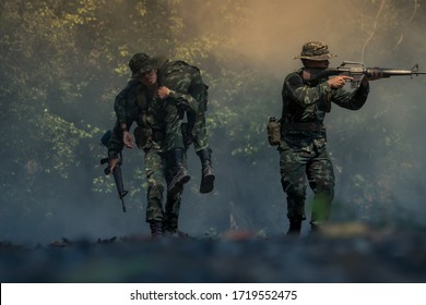 army soldier with rifle and machine gun moving .Thai army soldier in combat uniforms with machine gun.