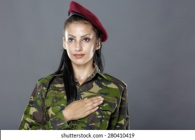 Army soldier swear solemnly with hand on heart to defend country