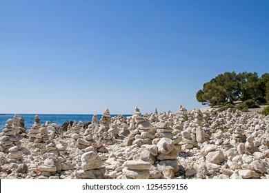 An army of stone towers gather here on the peninsula Zlatni rt