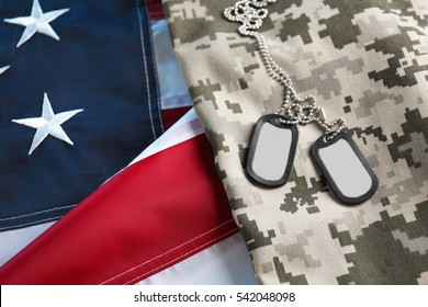 Army tokens on military uniform and USA national flag background