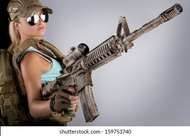 Army woman with gun