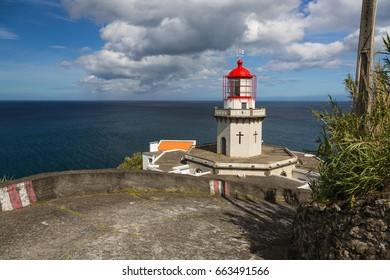 Arnel Lighthouse near Nordeste on the Sao Miguel Island. The island belongs to the Azores archipelago in the Atlantic Ocean.