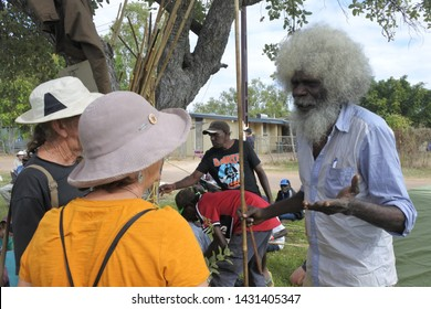 ARNHEM LAND, NT - JUNE 08 2019: Indigenous Australian man telling tourists about his heritage.Aboriginal people comprise 3% of Australia's population and 30% of them live in the Northern Territory.
