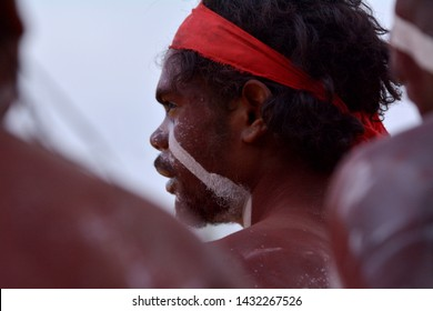 ARNHEM LAND, NT - JUNE 08 2019:Indigenous Australians aboriginal adult man dancing a cultural ceremony dance in the Northern Territory of Australia.