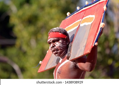 ARNHEM LAND, NT - JUNE 08 2019:Indigenous Australians aboriginal adult man dancing a cultural ceremony dance.