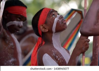 ARNHEM LAND, NT - JUNE 08 2019:Indigenous Australians aboriginal men dancing a cultural ceremony dance in Arnhem land at the Northern Territory of Australia.