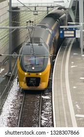 Arnhem, Neherlands - January 31, 2019: Train waiting at platform, viewed from above, at station Arnhem, Netherlands