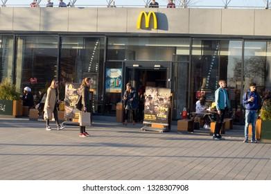 Arnhem, Netherlands - February 26, 2019: people at the new McDonalds near central staton Arnhem