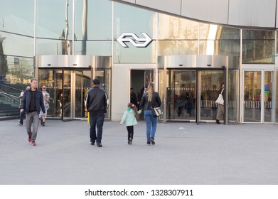 Arnhem, Netherlands - February 26, 2019: People walking in and out in the central train station of Arnhem