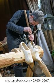 Arnhem, Netherlands - January 10, 2014: Clogs maker, a traditional Dutch craft of making wooden shoes.