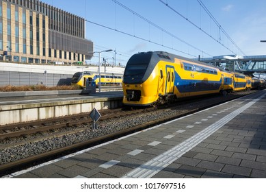 ARNHEM, THE NETHERLANDS - January 22, 2018; Intercity double decker train depart from Arnhem Central Station.