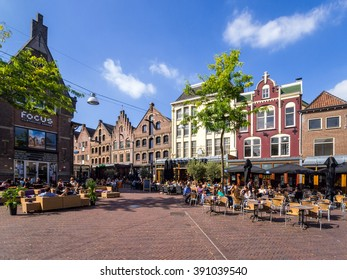 Arnhem, the Netherlands, July 7, 2012: The Korenmarkt square in the center of Arnhem with people relaxing outside in the sun
