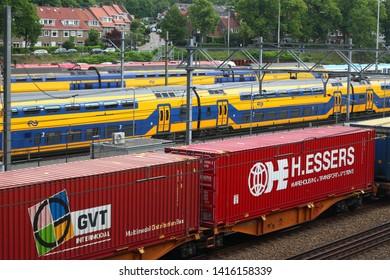 Arnhem, Netherlands - June 3, 2019: Cargo and passenger trains at the railway yard in the center of Arnhem