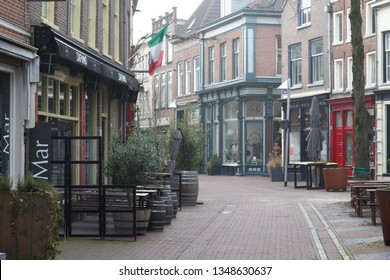 ARNHEM, NETHERLANDS - MARCH 22, 2019: Nice and picturesque ancient streets in the center of Arnhem, named Zwanenstraat and Kerkstraat