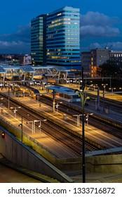 Arnhem, The Netherlands- March 3, 2015: Arnhem Central Station NS Trains during nighttime