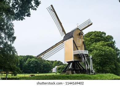 Arnhem, Netherlands - May 2018: back view of a yellow wind mills at Arnhem open air and national heritage museum.