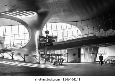 Arnhem, Netherlands - May 2018: A man walking by the hall of railway central station Arnhem with great architecture.