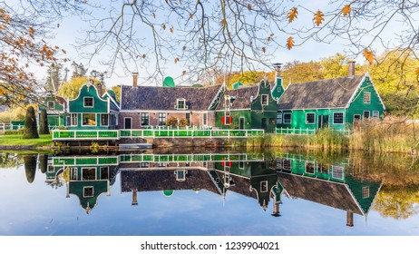 Arnhem, Netherlands - November, 04, 2018: Typical Dutch village with little green gable houses in the open air museum in Arnhem in the Netherlands