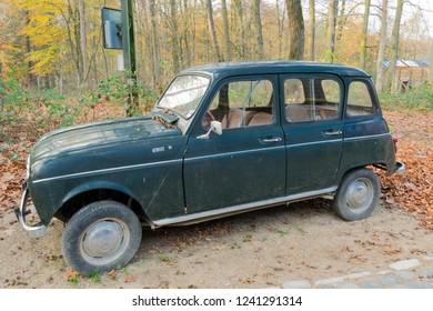 ARNHEM, NETHERLANDS - NOVEMBER 23, 2018: Vintage green Renault 4 parked in the Open air museum in Arnhem, Netherlands