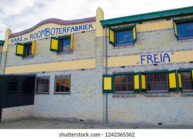 """ARNHEM, NETHERLANDS - NOVEMBER 23, 2018: Exterior of a Dutch cheese and butter factory called """"Kaas en roomboterfabriek"""" at the Open air museum in Arnhem, Netherlands"""