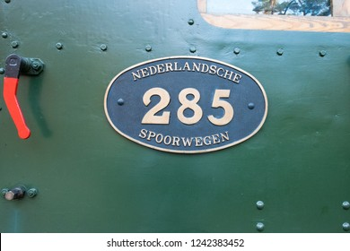 "ARNHEM, NETHERLANDS - NOVEMBER 23, 2018: Sign of the Dutch railway called ""Nederlandsche spoorwegen"" on a locomotive in the open air museum in Arnhem, a museum that shows the Dutch history"