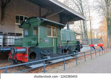 ARNHEM, NETHERLANDS - NOVEMBER 23, 2018: Vintage train locomotive in the open air museum in Arnhem, a museum that shows the Dutch history
