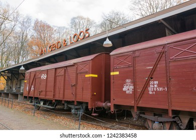 ARNHEM, NETHERLANDS - NOVEMBER 23, 2018: Vintage train station with a train wagon in the open air museum in Arnhem, a museum that shows the Dutch history