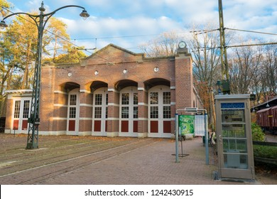 ARNHEM, NETHERLANDS - NOVEMBER 23, 2018: Typical Dutch train station with old vintage telephone booth in the open air museum in Arnhem