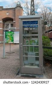 ARNHEM, NETHERLANDS - NOVEMBER 23, 2018: Typical Dutch old vintage telephone booth in the open air museum in Arnhem