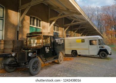 ARNHEM, NETHERLANDS - NOVEMBER 23, 2018: Typical Dutch old vintage delivery trucks in the open air museum in Arnhem