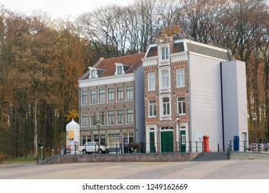 ARNHEM, NETHERLANDS - NOVEMBER 23, 2018: Two buildings representing the -Westerstraat-, a typical Dutch street in Amsterdam at the Open air museum in Arnhem