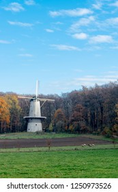 ARNHEM, NETHERLANDS - NOVEMBER 23, 2018: Big white windmill in the open air museum in Arnhem, Netherlands on a day in the fall