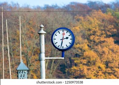 ARNHEM, NETHERLANDS - NOVEMBER 23, 2018: Close up of a typical Dutch station clock at the open air museum in Arnhem