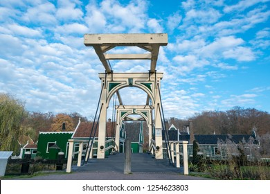 ARNHEM, NETHERLANDS - NOVEMBER 23, 2018: Double drawbridge with typical dutch houses on the background, in Dutch open air museum in Arnhem, Netherlands