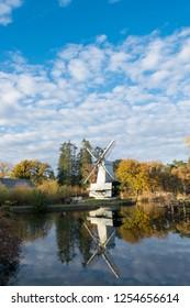 ARNHEM, NETHERLANDS - NOVEMBER 23, 2018: A typical Dutch landscape with an old windmill in the Dutch open air museum in Arnhem, Netherlands