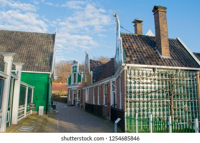 ARNHEM, NETHERLANDS - NOVEMBER 23, 2018: Typical Dutch street with old houses with at the open air museum in Arnhem, Netherlands