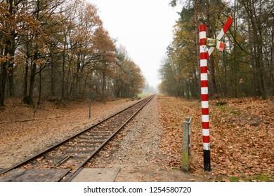 ARNHEM, NETHERLANDS - NOVEMBER 24, 2018: Train tracks with a railroad crossing in Arnhem, Netherlands