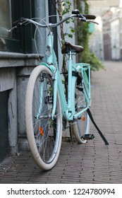 ARNHEM, NETHERLANDS - NOVEMBER 4, 2018: A mint green B'twin bicycle parked in shopping center of Arnhem