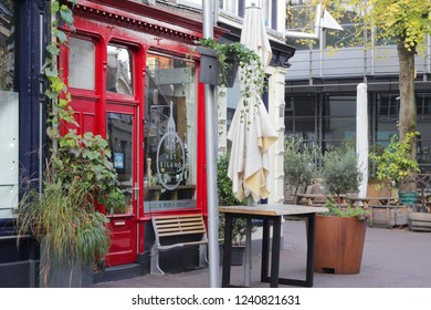 ARNHEM, NETHERLANDS - NOVEMBER 4, 2018: Small ancient restaurant 'Het Eiland' with an elegant red door and windows in the tourist center of Arnhem