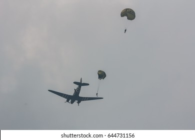 ARNHEM, NETHERLANDS SEP 20, 2014: Paratroopers jumping from a C-47 Skytrain