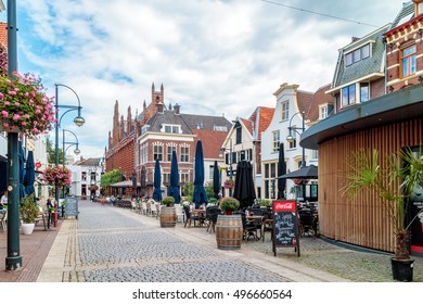 ARNHEM, THE NETHERLANDS - SEPTEMBER 19, 2016: Summer view of the city center with shops, bars and restaurants in Arnhem, The Netherlands
