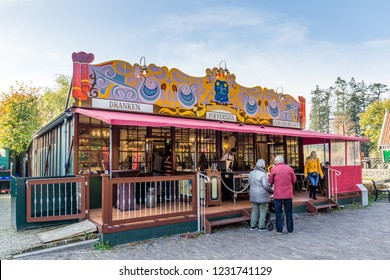 Arnhem,Netherlands- November, 04, 2018: Eldery couple wating to be served in front of an old Poffertjes stall
