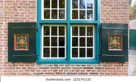 Arnhem,Netherlands- November, 04, 2018: Facade of a typical house with painted shutters in in the little cozy village HIndeloopen in  Friesland, Netherlands