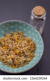 arnica herb detail background healing herbs