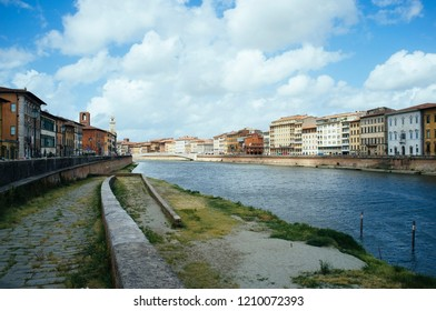 Arno river crosing Pisa City in Italy on a cloudy day