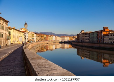 Arno river embankment with colorful old houses and Ponte di Mezzo . Picturesque medieval town of Pisa, Tuscany, Italy.